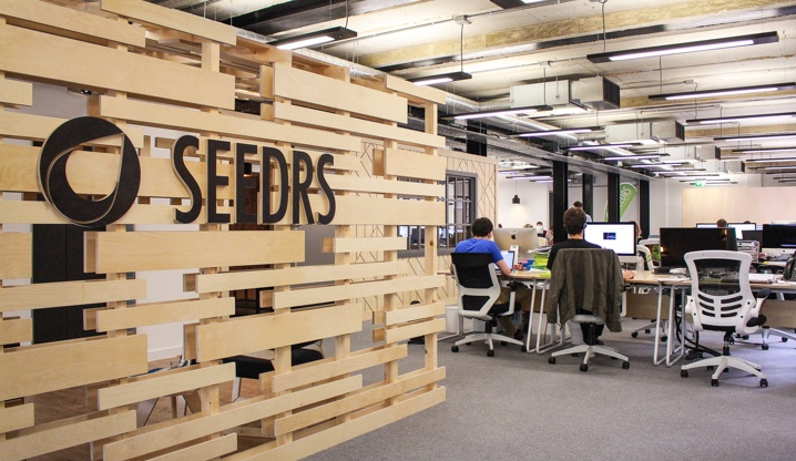 The Seedrs logo on a wooden screen at the London office